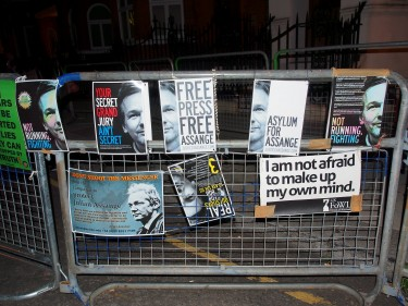 Placards and posters attached to crowd barriers outside the Ecuadorian embassy voicing support for Wikileaks founder Julian Assange. Image by Pete Riches, copyright Demotix (16/08/12).