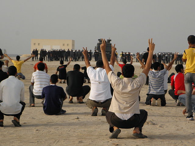 Protesters face riot police in Karbabad, Bahrain. Photo by Bahraini Activist. (CC BY-SA 3.0)