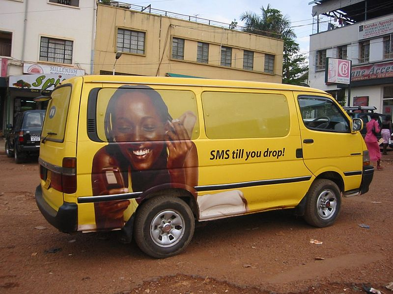 Telco ad on a van in Kampala, Uganda. Photo by futureatlas.com via Flickr (CC BY 2.0)
