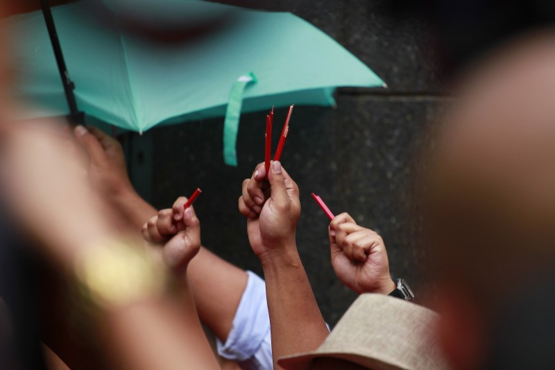 Red pencils were broken in half to symbolize media violence in Malaysia. Photo by Sam Ruslan, Copyright @Demotix (1/4/2014)