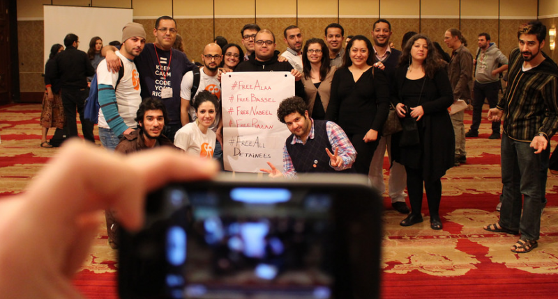 Arab Bloggers Meeting participants hold a sign calling for the release of jailed colleagues. Photo by Hisham Almiraat, used with permission.