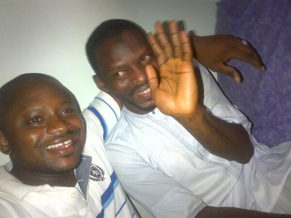 Yusuf Siyaka Onimisi (waving) with Lawal Haruna (@lawalharuna) shortly after his release. Photo from  @lawalharuna.