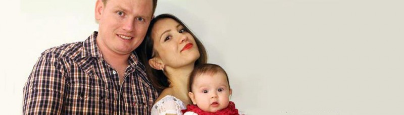 Alex Sodiqov with his wife and baby. Photo used with permission.