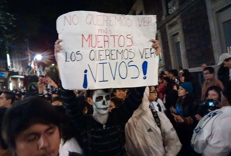 "Demonstrators in Mexico, Oct. 2014. Poster reads: ""We don't want to see more dead / We want to see them alive!"" Photo by PetrohsW via Wikimedia Commons (CC BY-SA 4.0)"