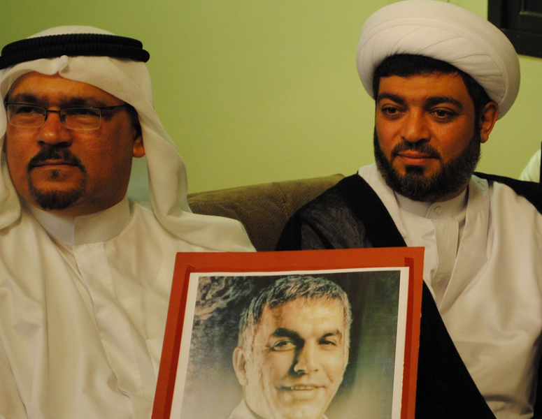 Jalal Fayrooz and Hussain al-Dehi, leading members of Al Wefaq in solidarity with Nabeel Rajab. Photo by Mohamed CJ via Wikimedia Commons (CC BY-SA 3.0)