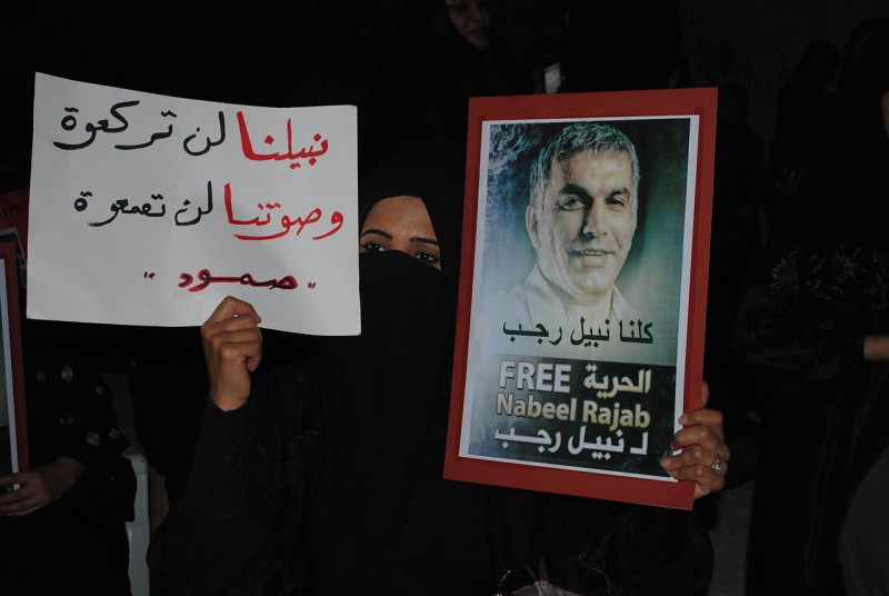 Woman holding a posted in solidarity with Rajab, by Mohamed CJ, used with permission (CC BY-SA 3.0)