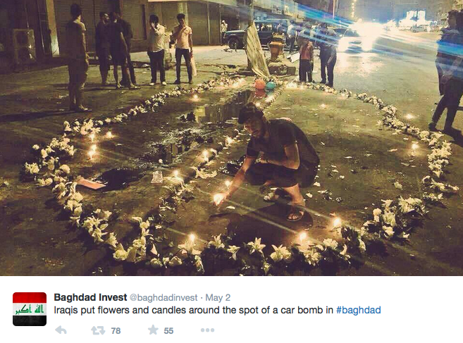 People lit candles at the site of the car bombing in Al-Karrada, Baghdad. Photo via @baghdadinvest on Twitter.