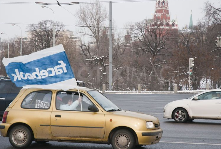 Car with Facebook flag, Moscow 2012. Photo by Irina Firsova. Copyright Demotix.