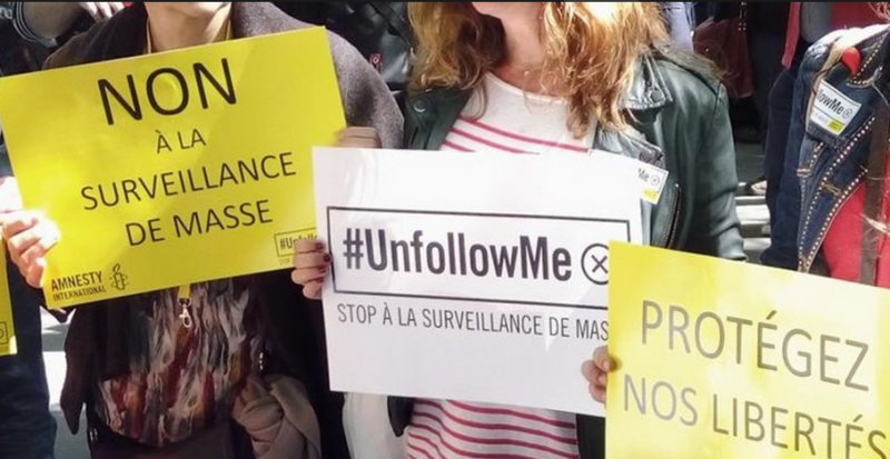 Anti-surveillance demonstration in France. Photo via Amnesty International.