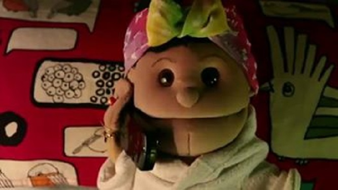 Abla Fahita, a comical hand puppet and sidekick of Egyptian television comic TKTK. The pupeet became the target of scrutiny after she was featured in a controversial Vodafone ad in 2013. Screen capture from advertisement via Mada Masr.
