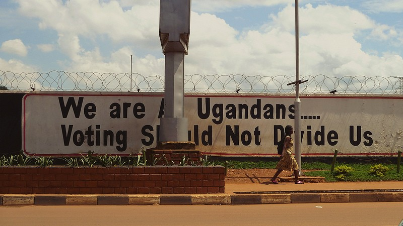 """We are all Ugandans....voting should not divide us."" Poster in Uganda, 2012. Photo by pixelthing via Flickr (CC BY-SA 2.0)"